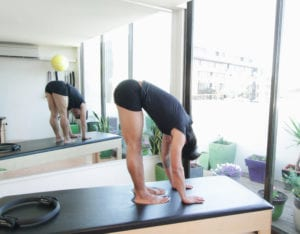 The Roll Down for a sore spine and neck